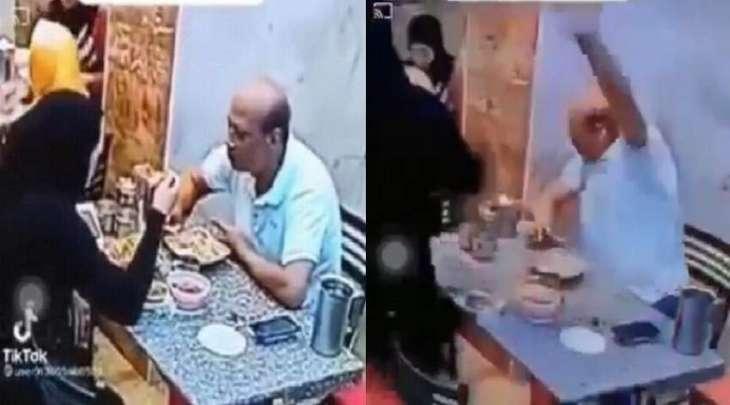 شاھد :  سیدة مصریة تعتدی علی زوجھا بالضرب داخل محل کشري