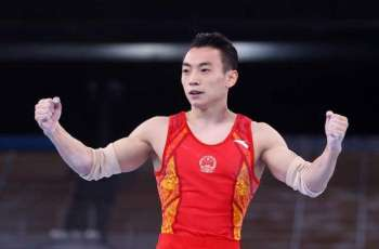Chinese Gymnast Zou Wins Olympic Gold in Parallel Bars Competition at Tokyo Games