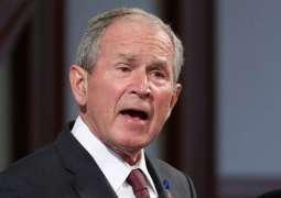 شاھد : جندی یھاجم الرئیس الأمریکي السابق جورج بوش و یطالبہ بالاعتذار للعراقیین