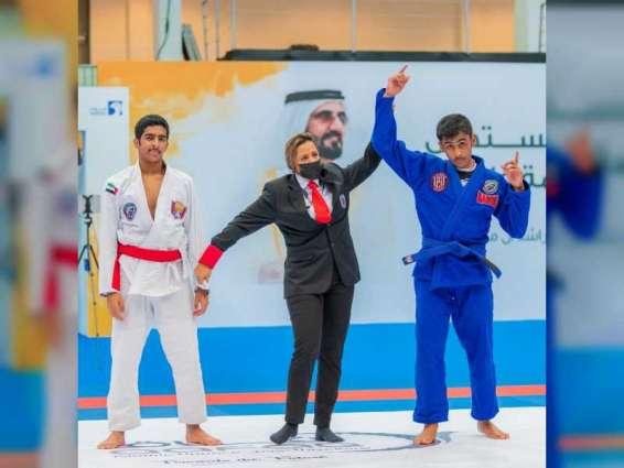 منصور بن محمد بن راشد يتوج الفائزين في ختام كأس نائب رئيس الدولة للجوجيتسو